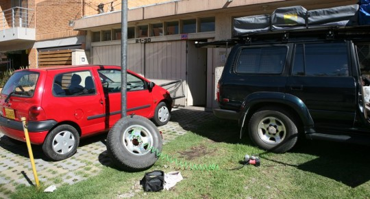 Fixing a flat tire in front of the AP bureau in Bogota