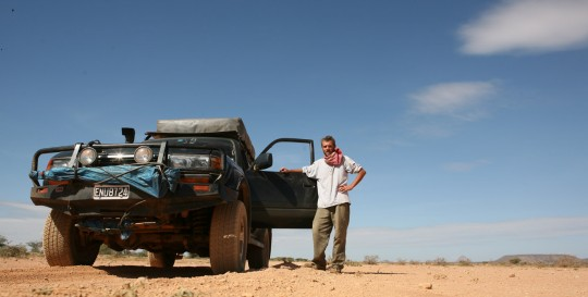 The traveler takes a break in the middle of the desert.
