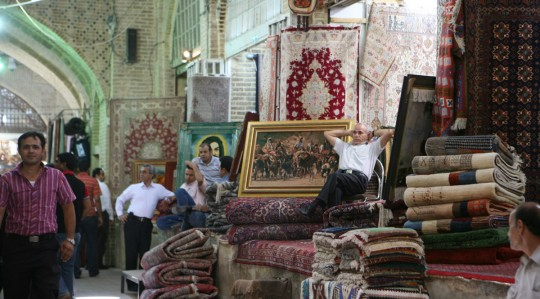 Selling carpets in a bazaar.