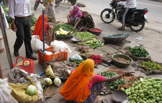 Selling vegetables in the street.