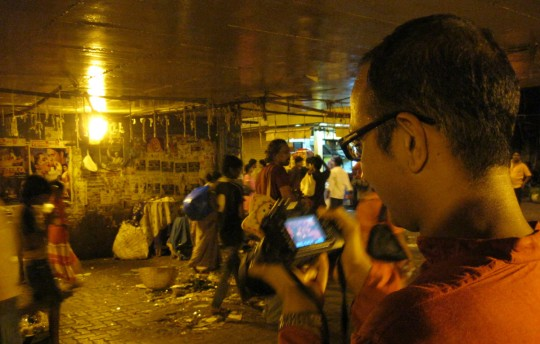 Vikas from the New York Times shooting pictures at night.