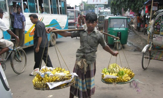 Boy selling bananas in a street of Chittagong.