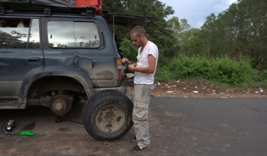 Fixing the tire. As long as it is not raining, we are OK.