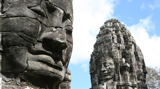 Giant smiling faces in Bayon, part of the fortified city of Angkor Thom.