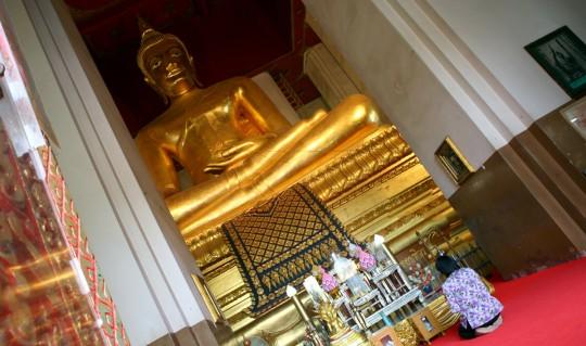 A giant Buddha in Wihaan Mongkhon Bophit.