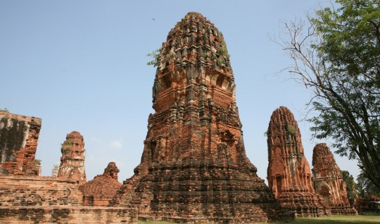 A Thai &quot;Chedi&quot; is a kind of pagoda. It has always the form of a lotus which symbolizes the enlightenment.