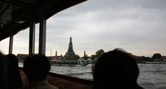 Wat Arun, along the river. Taking the boat is a convenient way of moving around in Bangkok.