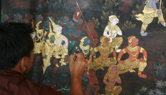 Painting restoration in Wat Phra Kaew, Bangkok.