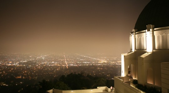 Griffith Park Observatory at night. Los Angeles underneath.