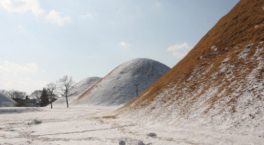 Tumulus after snow falls in the night.