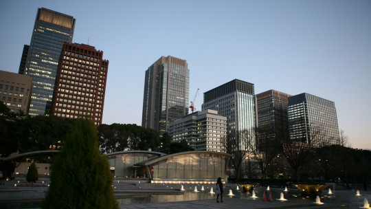 Walking in the business center in Tokyo at sunset.