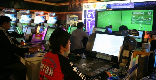People of all ages spend a lot of time in video game arcades.